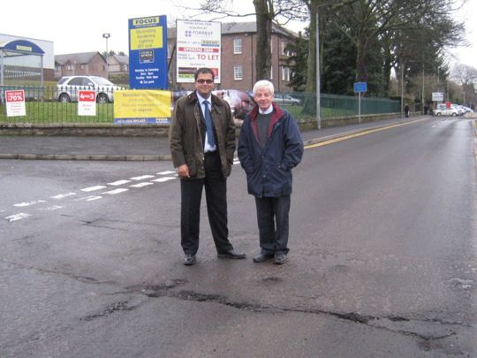 Sanjay and Cllr David May inspecting potholes in Forfar