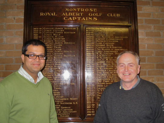 Sanjay with vice-captain, Brian Ritchie in front of Honours Board at Royal Montrose Golf Club